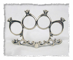 Brass knuckles wedding ring framed