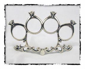 Brass knuckles wedding ring framed
